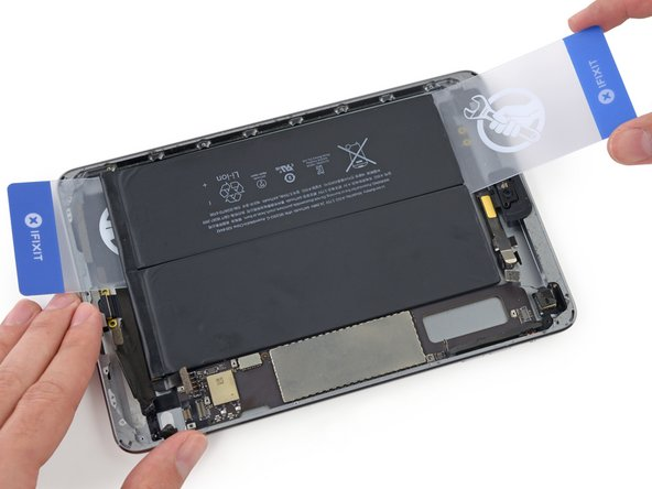 Remove the second card and reinsert it under the battery near the headphone jack.