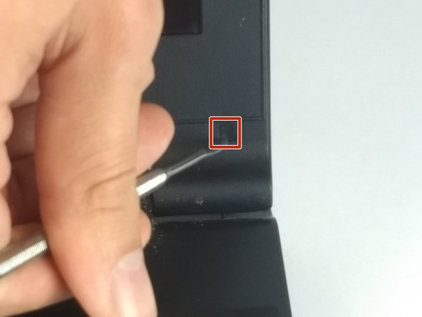 Remove the stickers covering the screws. These are located on both corners of the screen. (Two in total)