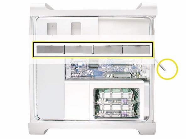 Before you begin, open the computer, and lay it on its side with the access side facing up.