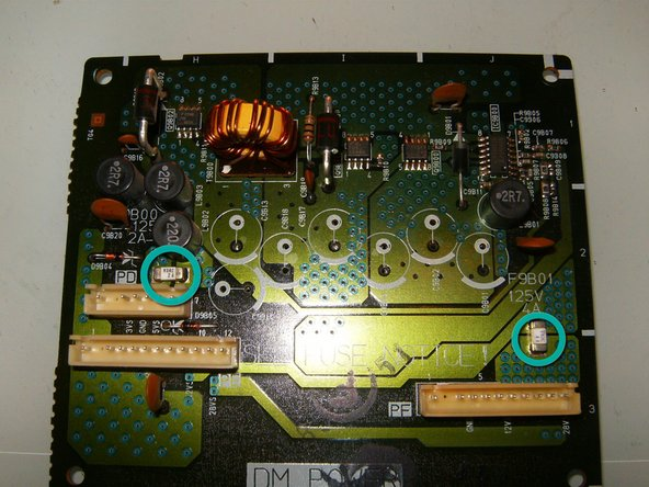 While the board and the DM power module are accessible check the SMD fuses for continuity. There are two on the daughter board. In this case, the fuses had continuity and were functioning.