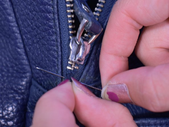 After putting the slider back on the zipper, sew the ends of the zipper to prevent the slider from sliding off.