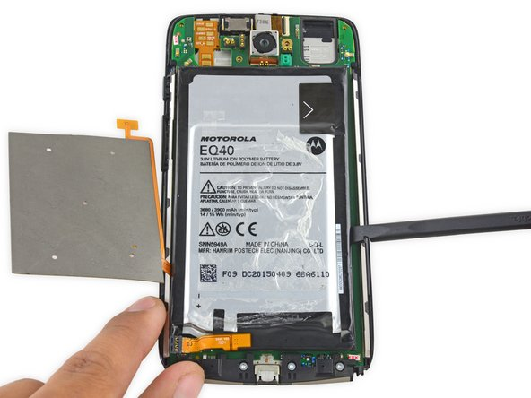 Use a spudger to gently pry the battery up from the rest of the device.