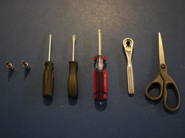 "Before we begin the disassembly, these are the tools you will need. In order, these tools are: T-15 bit, T-20 bit, Phillips head screwdriver, flat head screwdriver, 1/4"" drive socket driver, 1/4"" drive socket wrench, and a pair of scissors."
