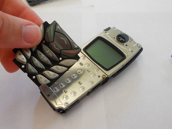 Simply remove the keypad from on top of the phone, and place it off to the side, leaving just the phone itself remaining