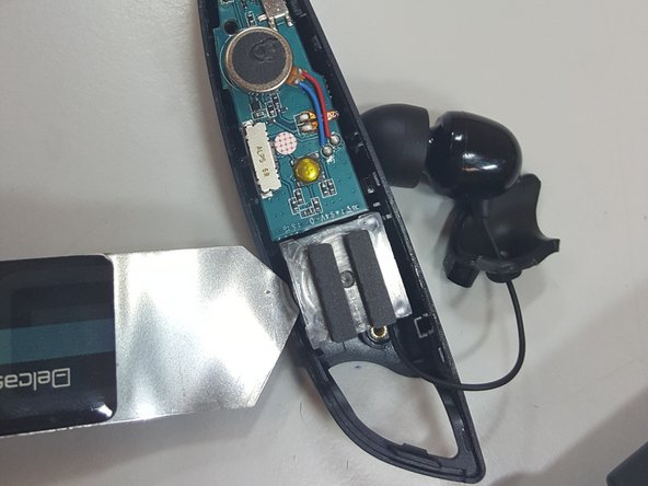 Using a pry/opening tool, slightly lift the speaker and motherboard out of place.