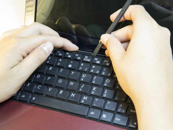 Turn the laptop right side up and lift the lid.