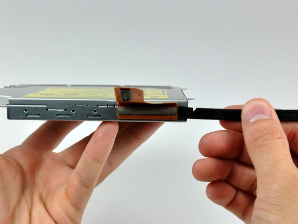 Use the flat end of a spudger to separate the optical drive connector from the optical drive.