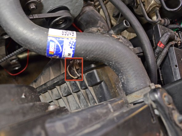 The engine air filter housing is located at the front of the engine bay, between the engine and the radiator.