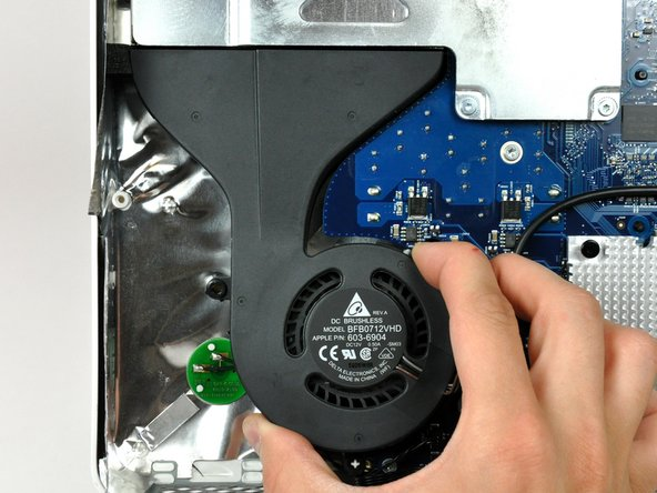 Lift the CPU fan off the plastic posts protruding from the rear case.