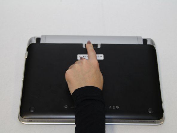 Flip the device over, so that the bottom cover is exposed.