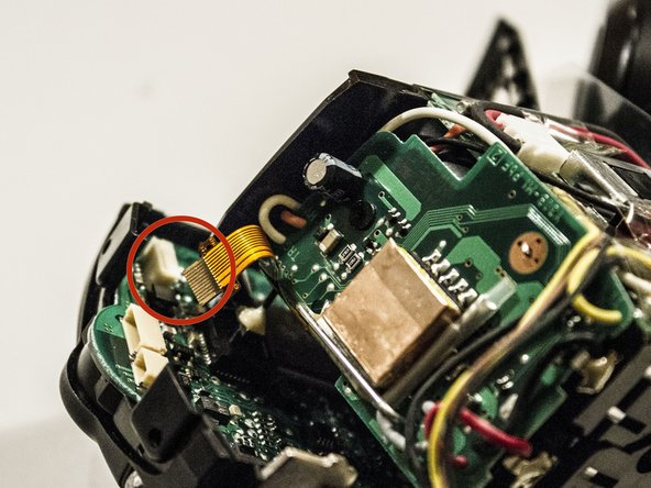 Gently pull flat band out of the circuit board mount. You might use the pliers but don't bend the band.
