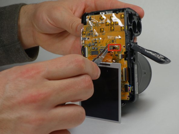 Disconnect the ribbons that connect the LCD screen to the camera gently using precision tweezers or fingers.