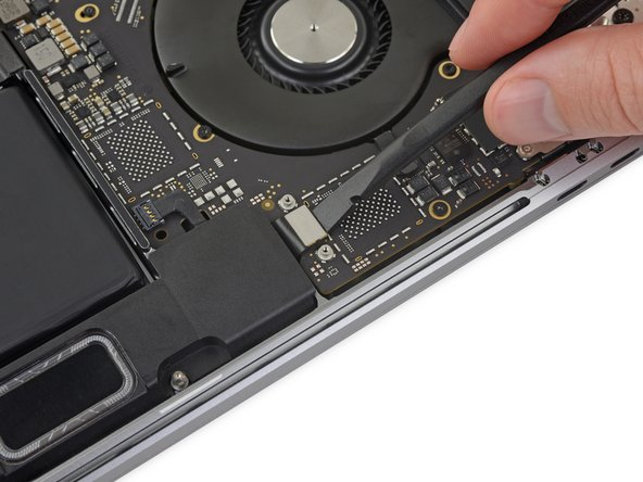 Disconnect the Touch Bar display cable by prying its connector straight up from the logic board.