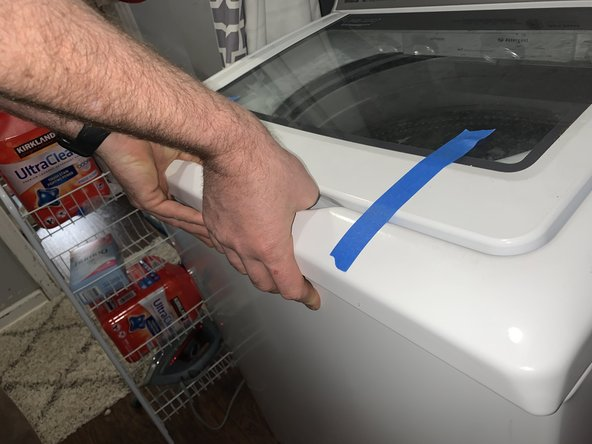 Tape the lid down so it does not open when removing.