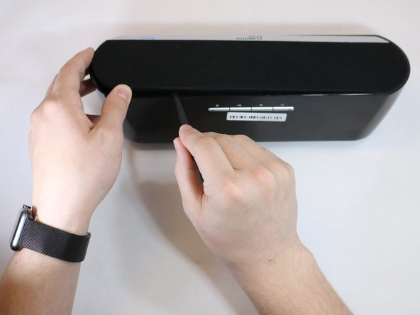 Remove front panel by forcefully placing the flat edge of the spudger in between panel and plastic. Angle spudger and use fingers to pry panel off.