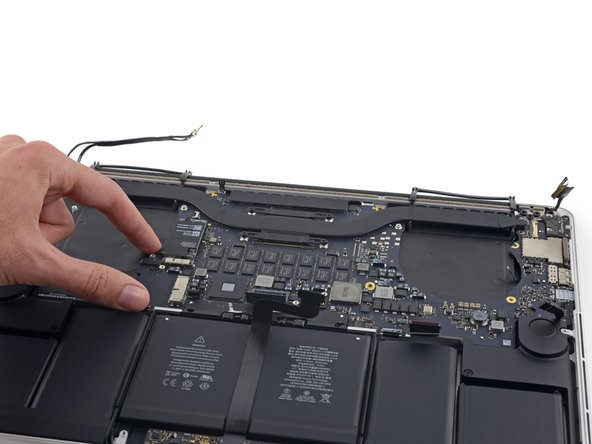 Lift and pull the entire logic board assembly away from the wall of the upper case.
