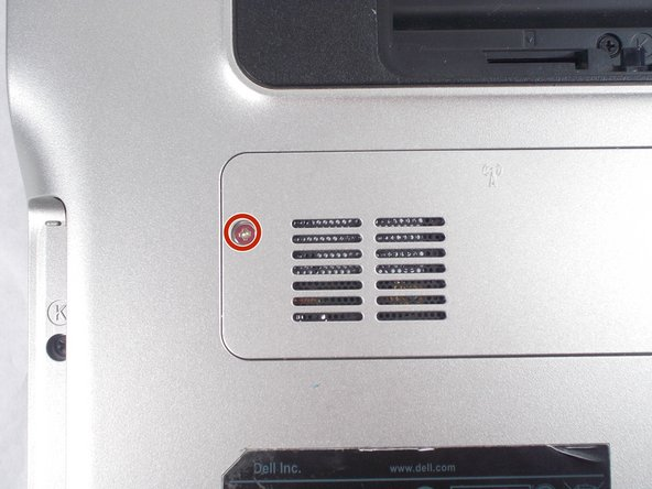 Locate the mini card access panel marked with a radio tower emblem on the bottom of the laptop near the battery bay.