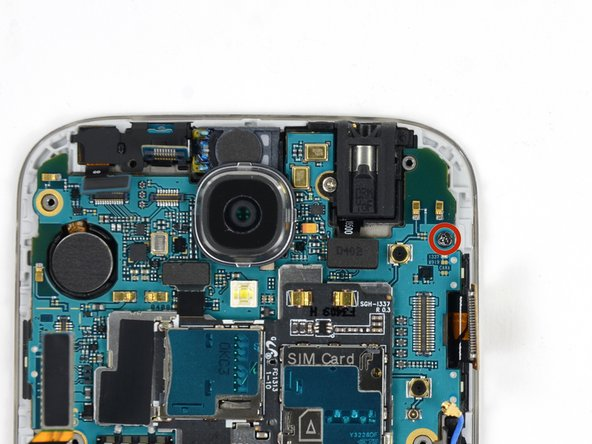 Remove the single 2.4 mm Phillips #00 screw from the motherboard assembly.