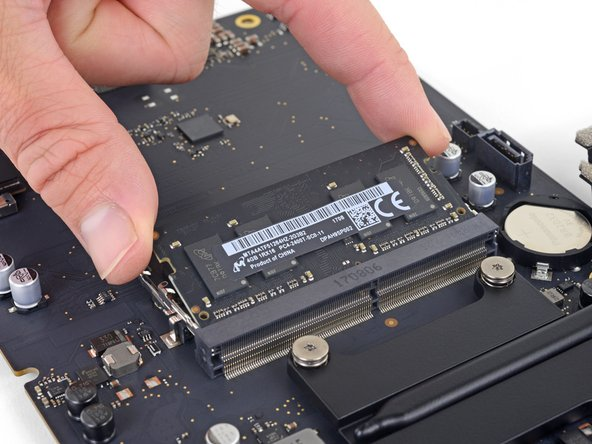 Lift the RAM module to an angle of about 30 degrees and slide it out.