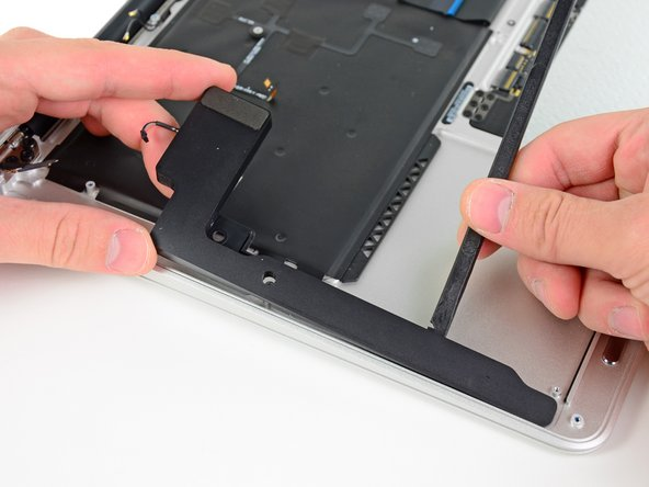 The speakers are stuck down to the upper case with some adhesive and can be easily removed.