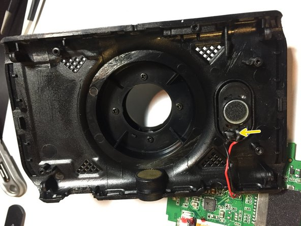 After the PCB board is taken loose from the housing, we see that we have two wires attaching a small speaker to the housing,