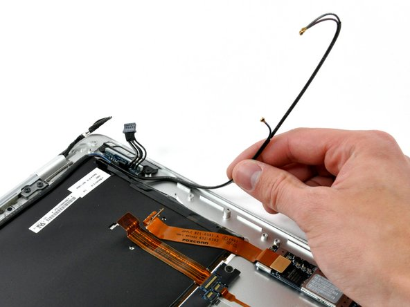 Peel the antenna cables up off the adhesive securing them to the upper case.