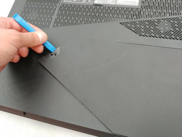 Pry up the triangular service cover with a plastic opening tool.