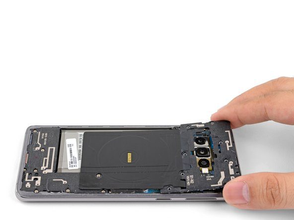 Lift the midframe from the top corners and remove it from the phone.
