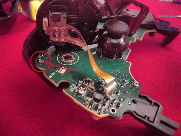 The screw for the bumper setups is on the opposite side of the motherboard, under the trackpad location.