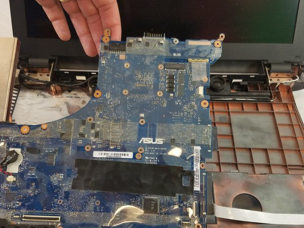 Ensuring no missed connections or screws, remove the motherboard from the assembly.