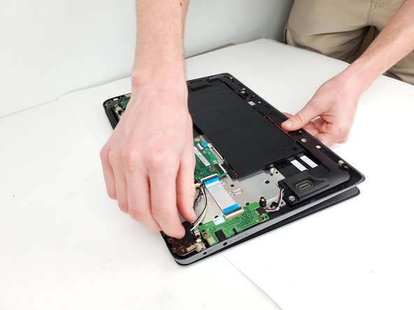 To remove the lid from the laptop, pivot each end on the hinge and lift the rest of the laptop up and away from the lid.