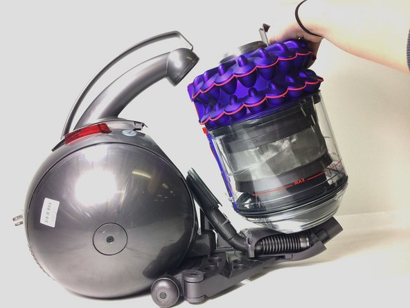 Remove the canister by lifting it out.