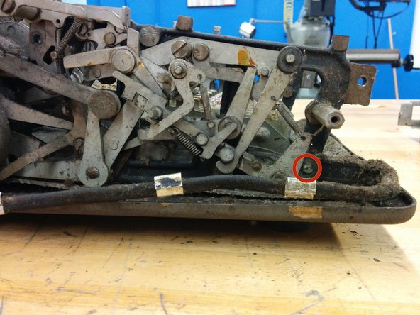 """On the right side front, unscrew this #8-36, 1"""" screw and remove the washer."""