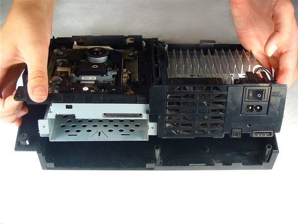 Lift the motherboard assembly from its front edge and remove it from the lower case.