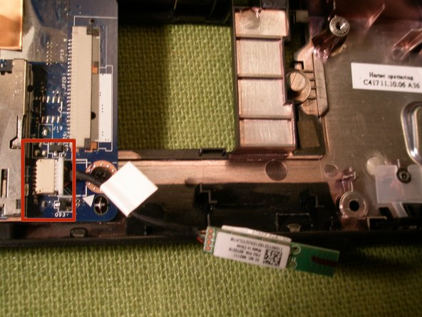 Unplug the Bluetooth cable from the system board and lift the module from the chassis to remove it.