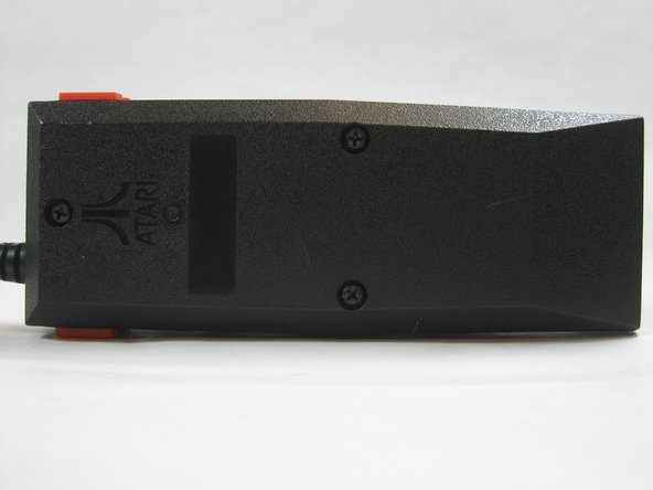 Turn the controller over, exposing the three screws on the back. Use a 6mm screwdriver to remove these screws.