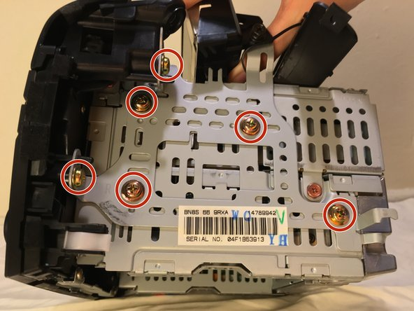On the right side of the unit, designated by the letter R, remove 6 screws using a Phillips #2 screwdriver.