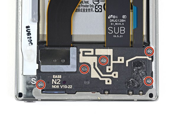 Use a Phillips screwdriver to remove the five 4mm screws securing the daughterboard cover.