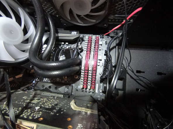 Locate the RAM modules. They can be found on the upper right section of the motherboard.