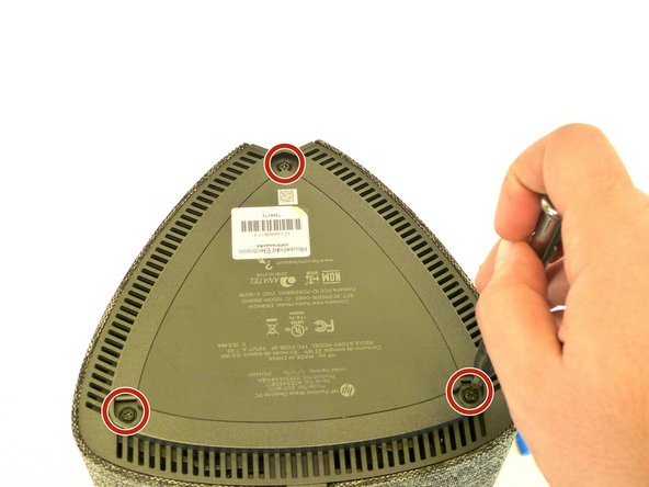 Remove the three 24 mm screws from the bottom cover using a Phillips #2 screwdriver.