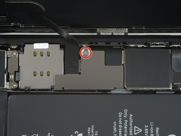 Remove the 1.25 mm-long Y000 screw securing the battery & display connector cover bracket.