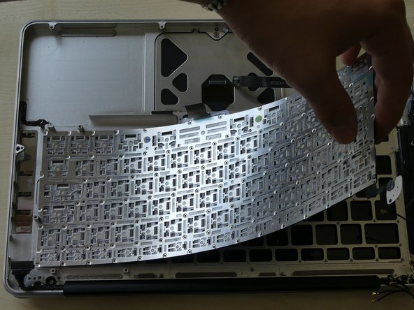 Now that you have removed all of the screws you can gently press on the face side of the keyboard and it will come right out. If you have removed ALL the screws!