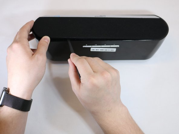 Remove front panel by forcefully placing the flat edge of the spudger in between panel and plastic. Angle spudger and use fingers to pry panel off. You may need to use extra force.