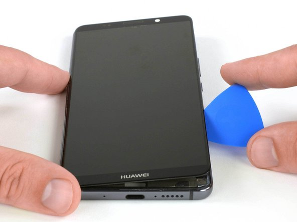 After cutting the adhesive on all sides of the phone, flip the opening pick to lift up the display.
