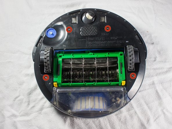 Using a Phillips #2 screwdriver, remove the captive screws that hold the bottom plate in place.