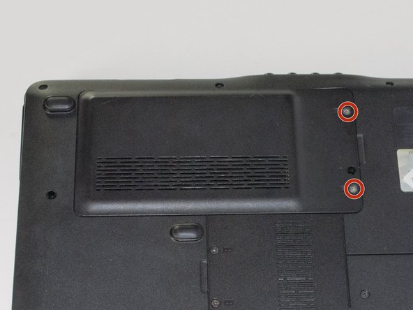 Start with the bottom of the laptop facing up.