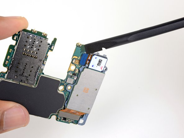 Use the flat end of a spudger to pry up and disconnect the ultrawide camera connector from the motherboard.