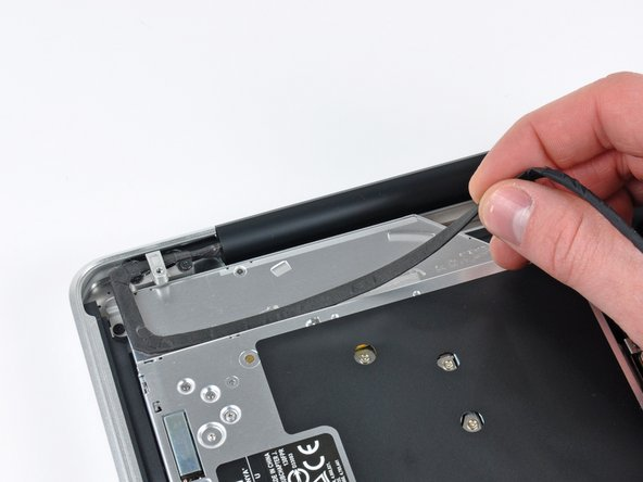 Peel the camera cable off the adhesive securing it to the optical drive.