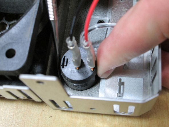 Press tabs on Power Switch to release the Power Switch and Push out.