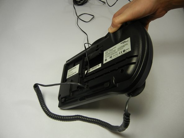 Turn the phone over to view the underside, where the handset cord connects.